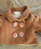 May áo khoác dạ ấm mà đẹp cho bé yêu