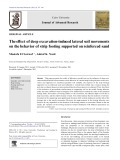 The effect of deep excavation-induced lateral soil movements on the behavior of strip footing supported on reinforced sand
