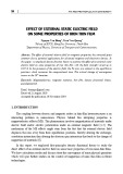 Effect of external static electric field on some properties of iron thin film