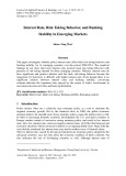 Interest rate, risk taking behavior, and banking stability in emerging markets