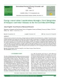 Energy-conservation considerations through a novel integration of sunspace and solar chimney in the terraced rural dwellings
